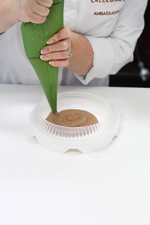 Pipe the prepared chocolate mousse into the Silikomart