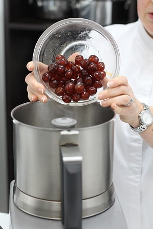 cherries and raspberry jam into a food processor